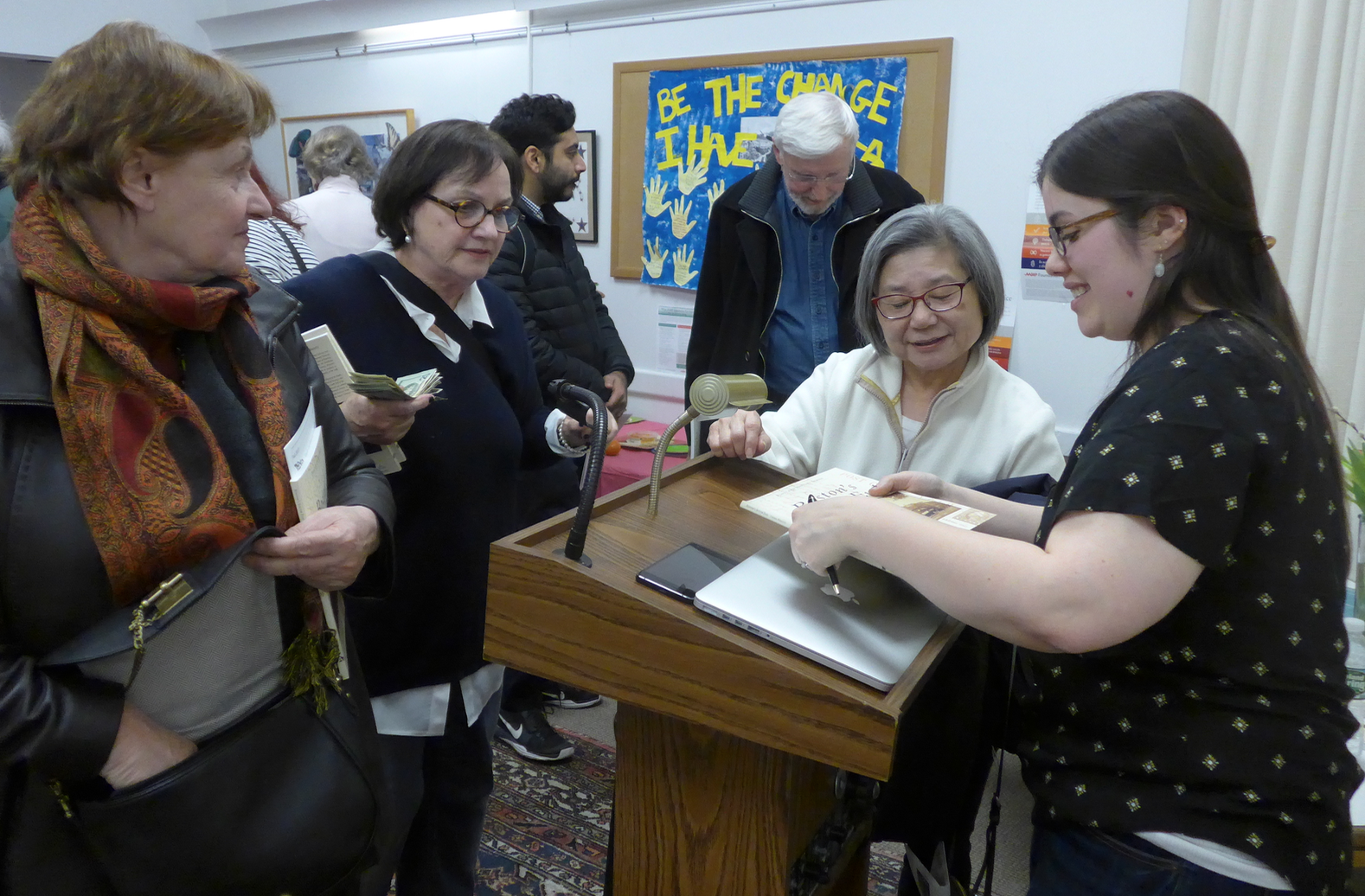 Lauren Prescott, executive director of the South End Historical Society,signing copies of  Boston's South End, a Postcard History,  at the South End Library