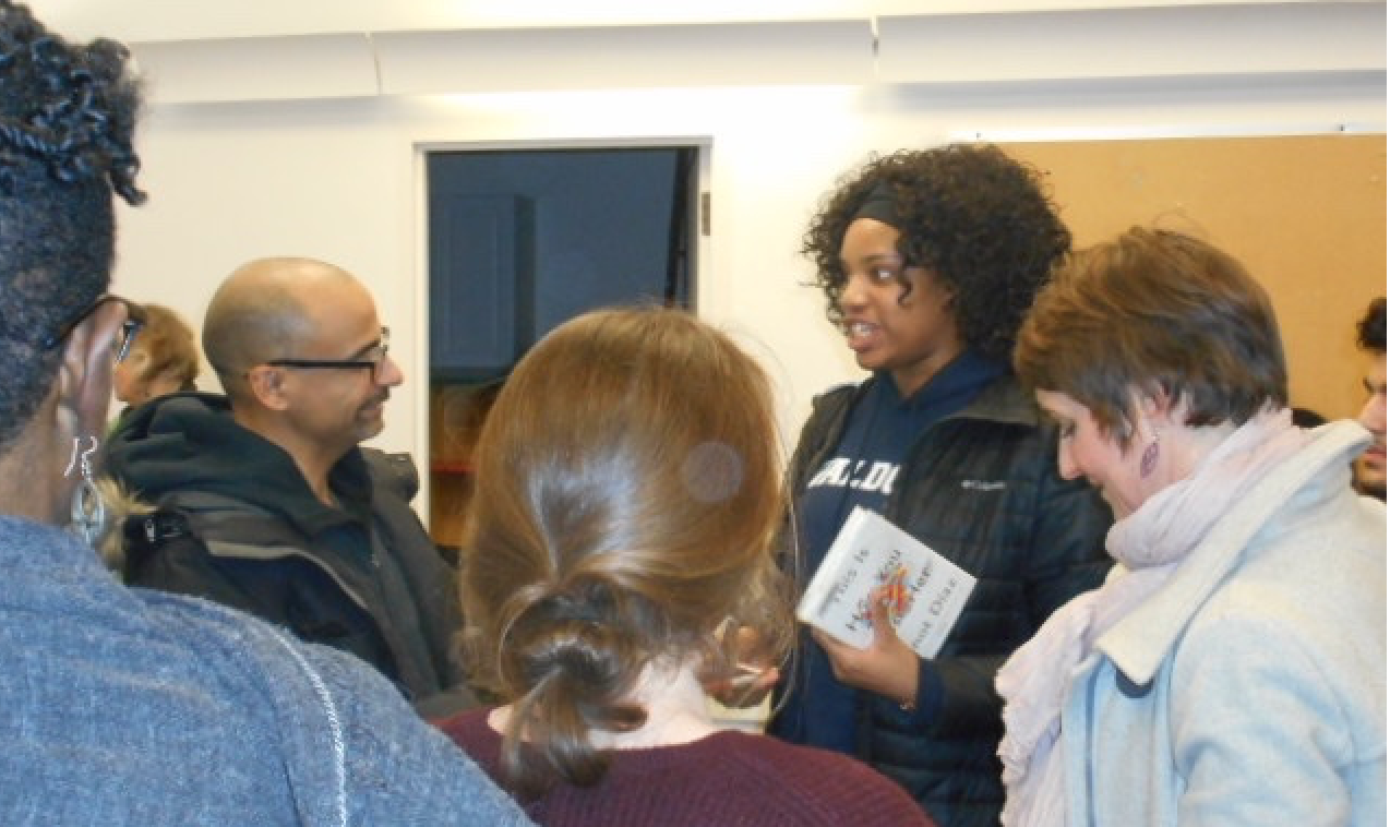 Junot Diaz surrounded by admirers after his reading