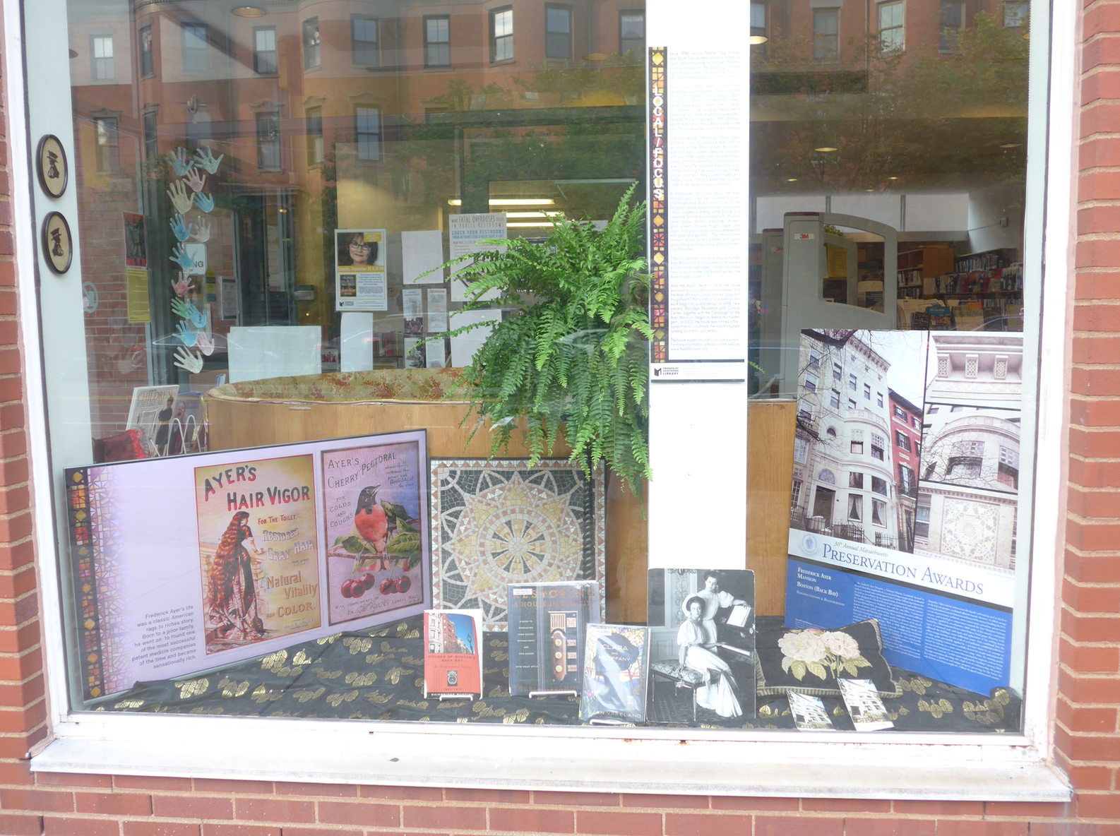 The September Local/Focus installation in the Tremont Street window of the South End library