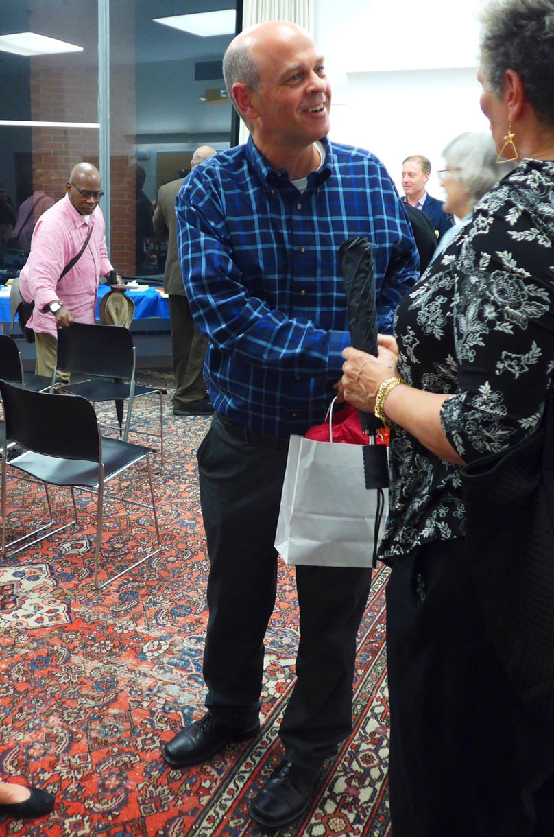 Artistic director/conductor Gil Rose greeting admirers at last year's Odyssey Opera event at the South End library
