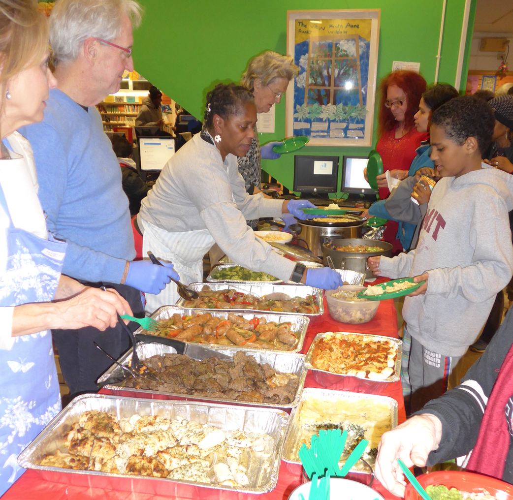 FOSEL board members, library staff and volunteers dishing out delicious dinners for all