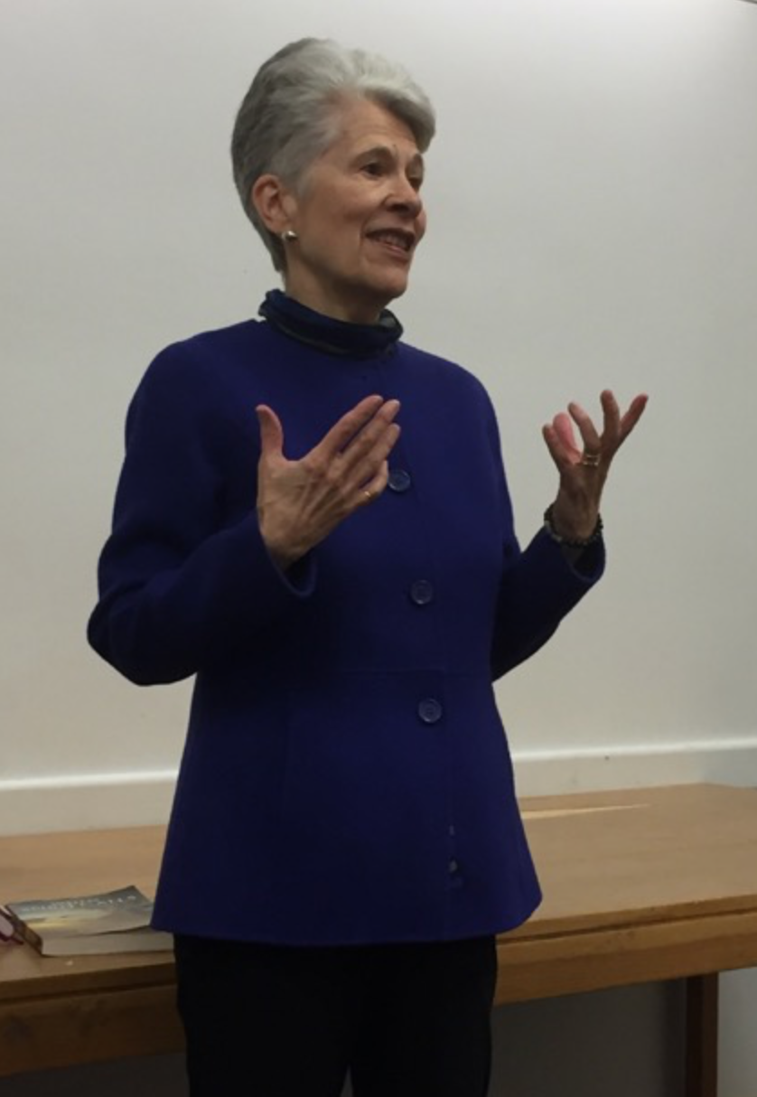 Joan Diver answering questions from an engaged audience about her spiritual voyage