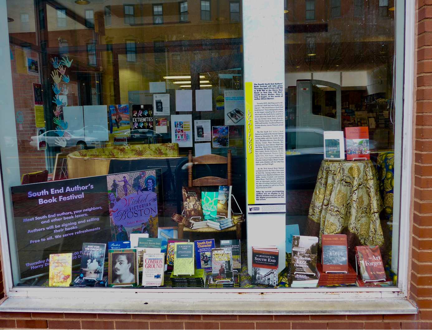 A selection of the many titles by South End authors participating in the Fourth Annual South End Authors' Book Festival in Tent City on display in the South End library window