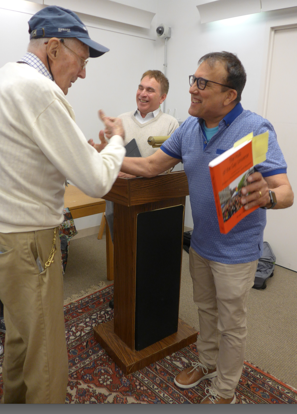 Urban historian, Russ Lopez, greets new South End resident John Thomson
