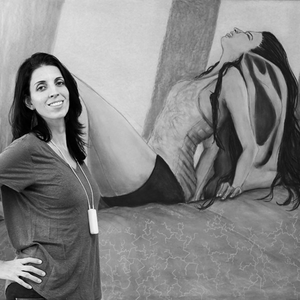 "Priscila poses in front of one of her paintings, ""Weigh,"" which represents the weight felt by hearing loss. Source:    My Luckyears   ."