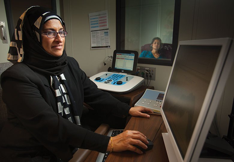 Emerging Research Grants (ERG) recipient Dr. Wafaa Kaf administers a hearing screening. Credit: Missouri State University.