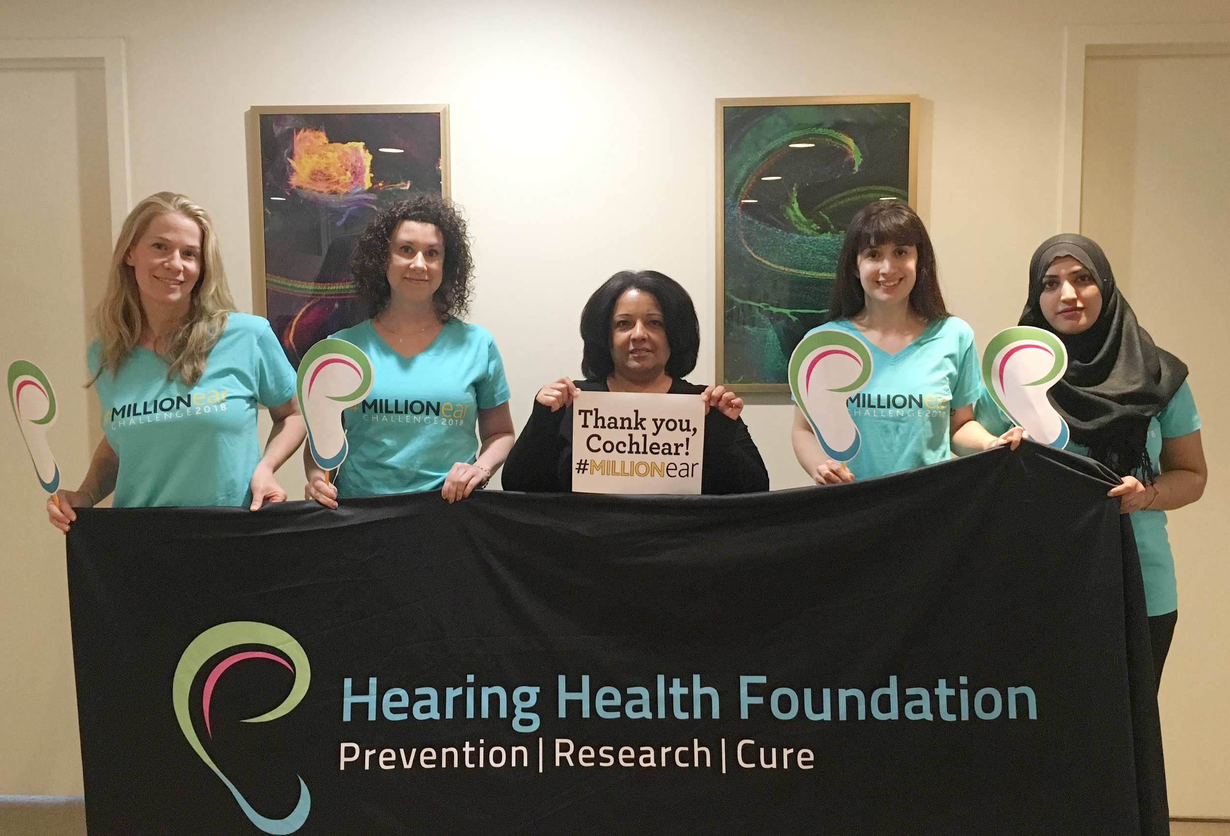HHF staff thanks Cochlear in their own #MillionEar Challenge shirts.
