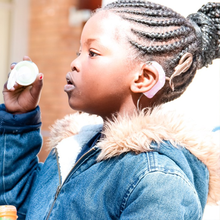 A young student with hearing loss. Credit:    Carel du Toit   .