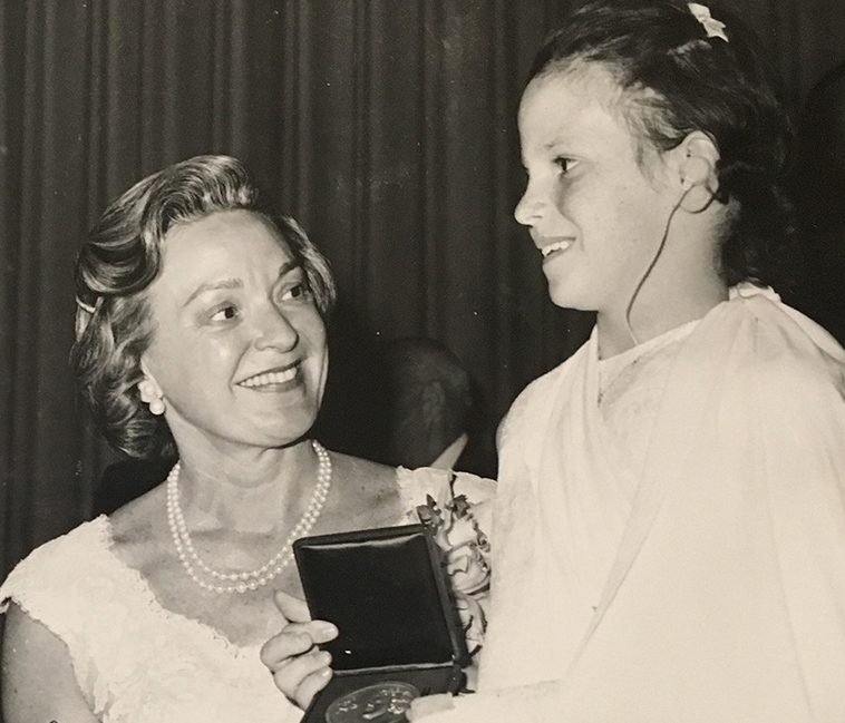 June 1966: Collette Ramsey Baker (left) is presented with an award at the Rotary Club of New York.