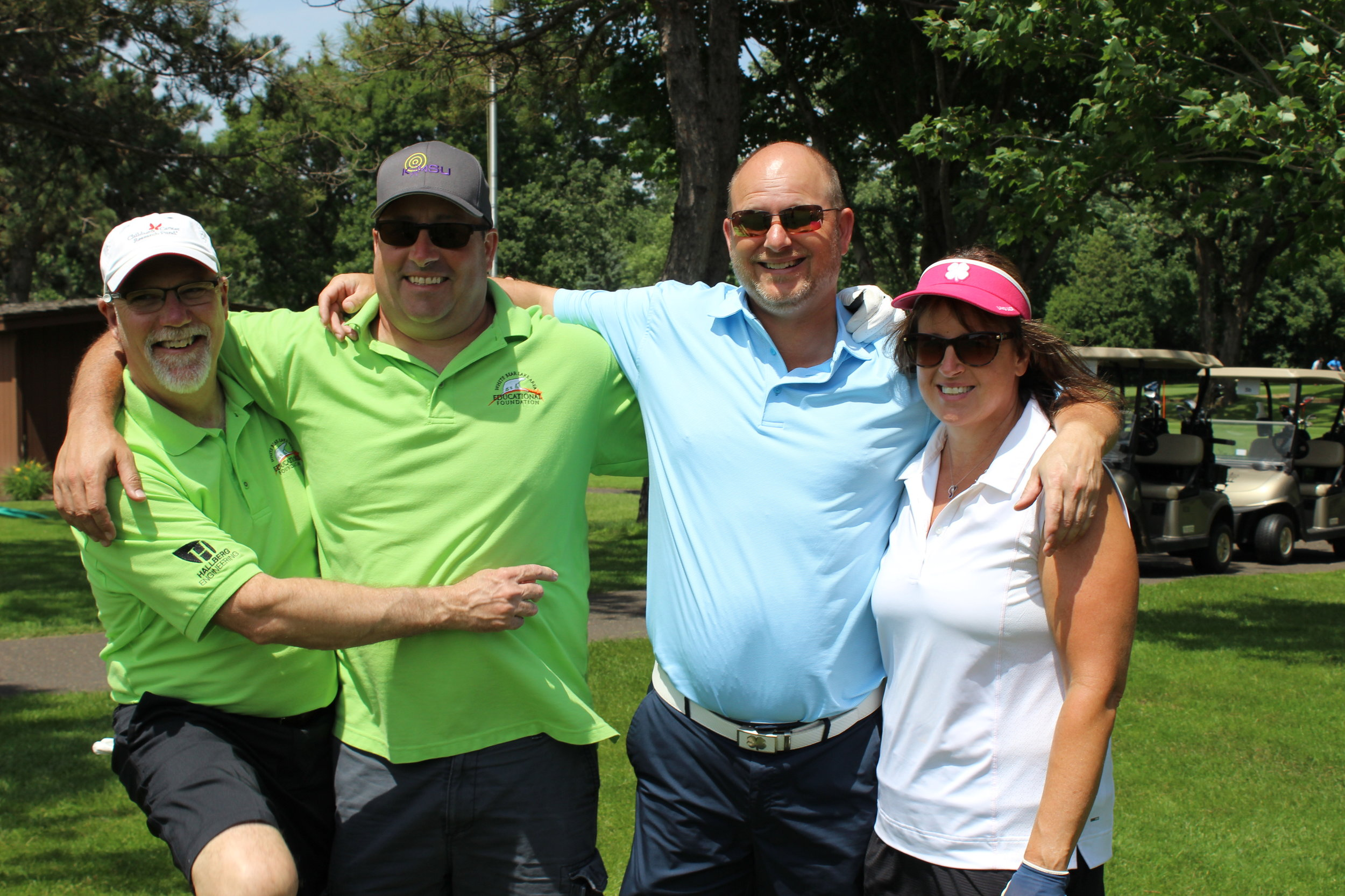 Tim Hank, Pete Carroll, Darin Pilacinski, Beth Pilacinski.jpg