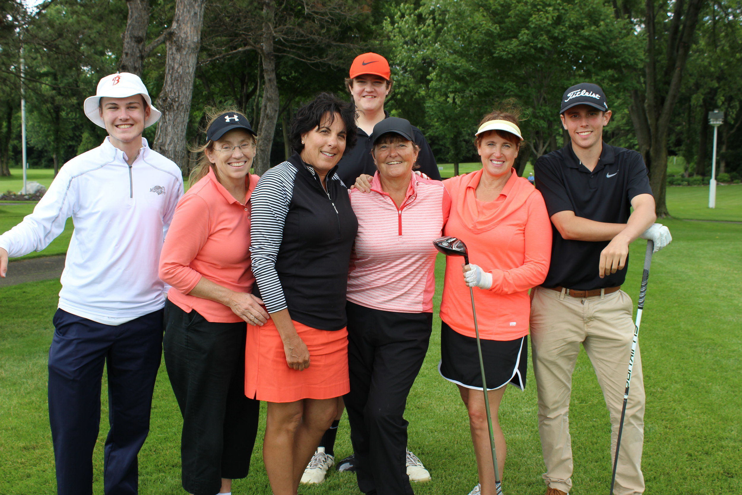 14A Mary Cox, Cathy Poechmann, Sue Ryan, Beth Pilacinski w boys golf players.JPG