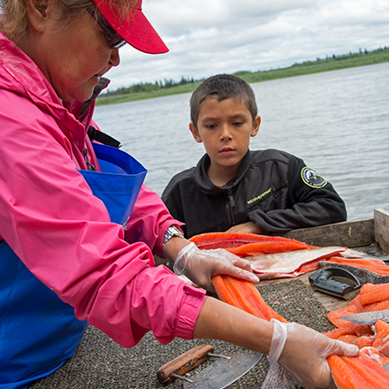 A+small-boy-learns-to-cut-salmon-from-grandmaP98.jpg