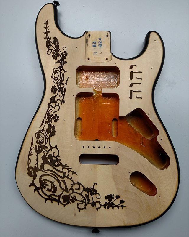 Custom laser etched guitar. 1/16 inch deep