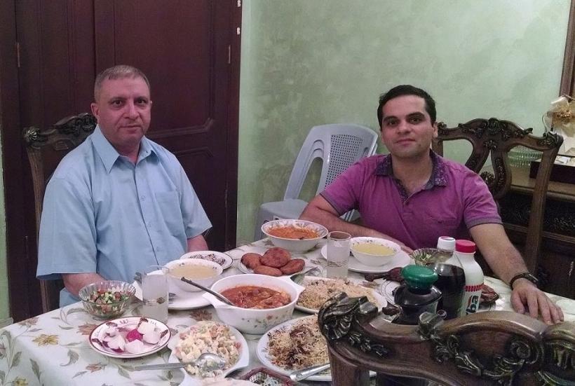 Louis Yako's (right) first meal of Ramadan with an Iraqi professor (Photo credit: Louis Yako, 2014)