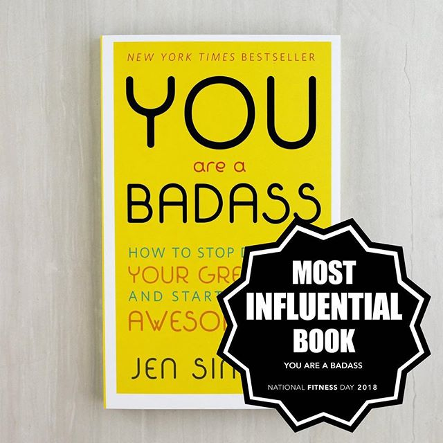"""Congratulations to our final #NationalFitnessDay Award winner for Most Influential Book, """"You Are a Badass"""" by @jensincero! . Jen Sincero's You Are a Badass: How to Stop Doubting Your Greatness and Start Living an Awesome Life continues to grow in popularity and make waves in health and wellness circles, as it's the kind ofbook that everyone who reads immediately wraps up as a gift for their friend's next birthday, or quarter life crisis. . And you'll quickly understand why. Jen does a powerful job at helping you change your way of thinking - diving into the unwarranted beliefs that hold us back, practices in self-love and self-acceptance, and offering a much-needed push to go after a life you utterly love. But, as compared with other self-help books you may have embarrassedlyburied under your bed, Jen gives a very millennial, no bullsh*t, laugh-out-loud, and sometimes even crass twist to the traditional genre. She starts the book by telling her reader that she beat a pillow with a baseball bat, ceremoniously """"married herself,"""" and even wrote a letter to her uterus all so that he or she doesn't doesn't have to. . For all this year's winners check out the link in our bio! 👆🏽🏆"""