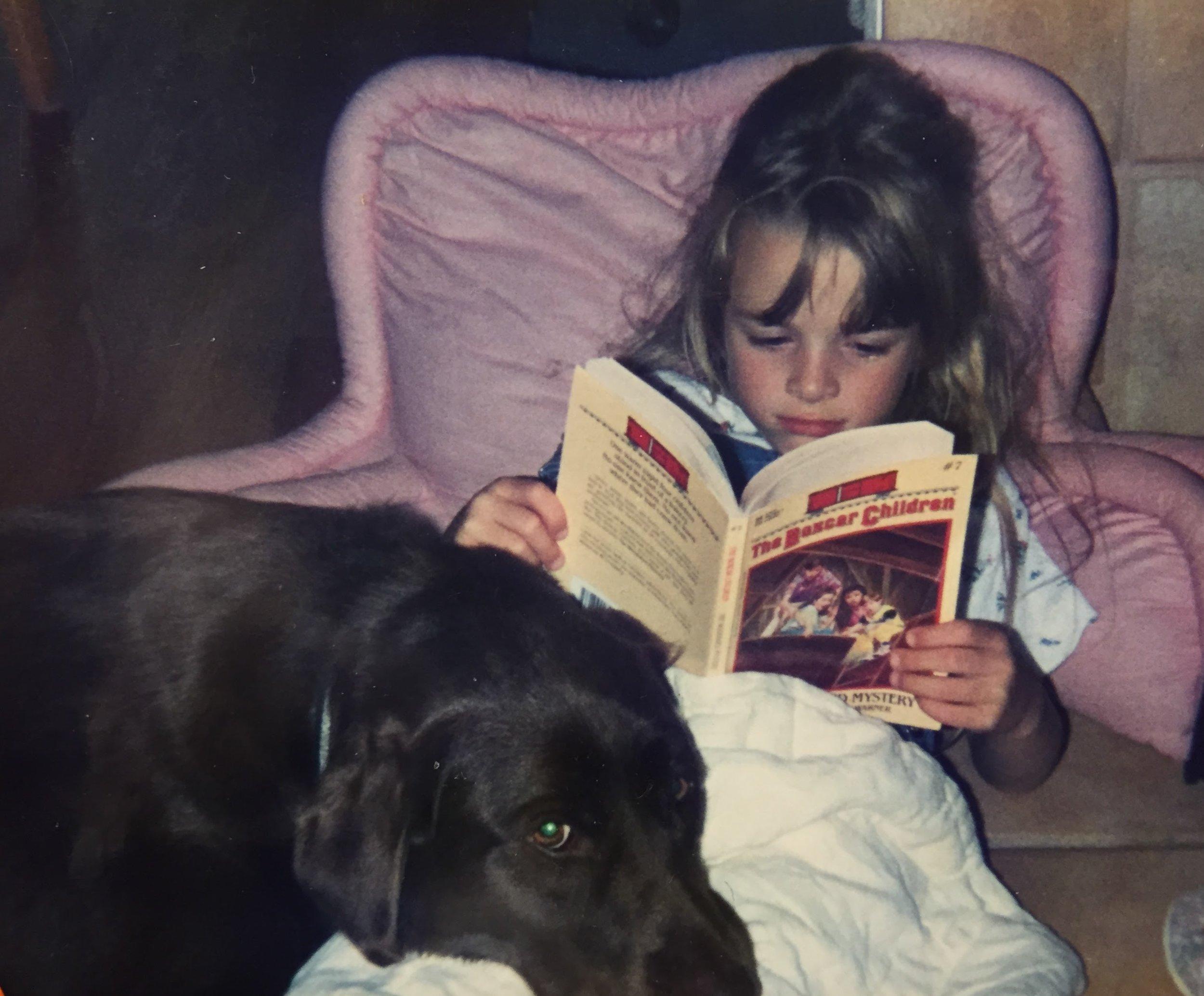Me reading with Fudge, circa 1995.