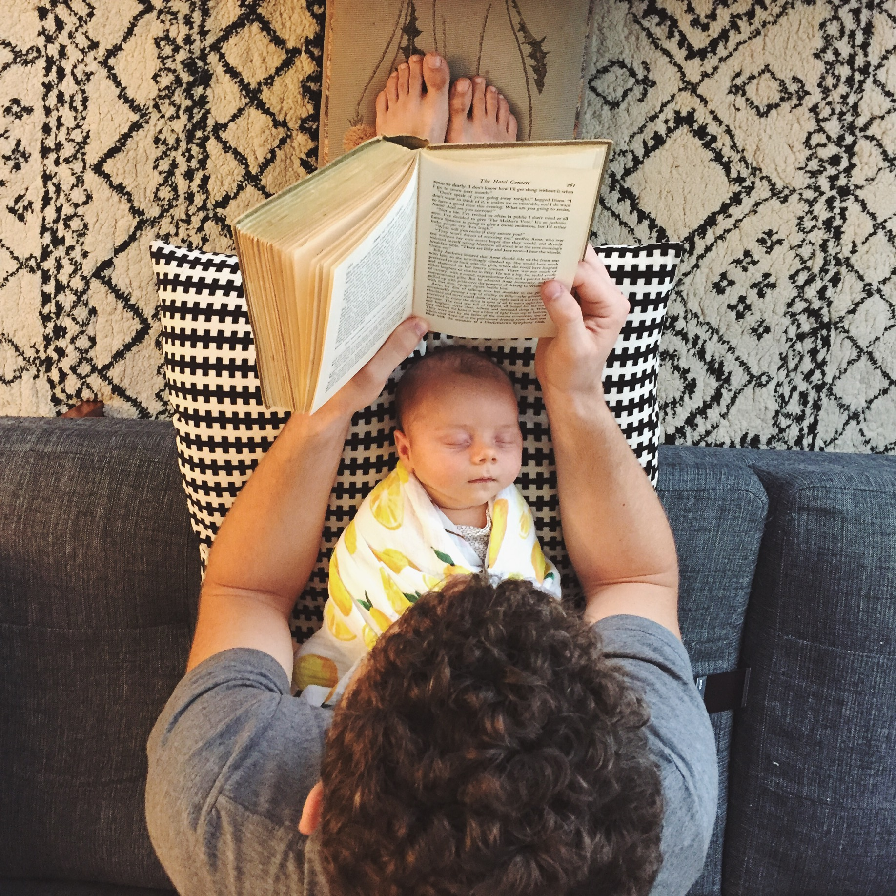 "People told us, ""Have a baby and you'll never have time to read again!"" I would like to offer this photo as evidence for the defense. Ella is 1 month old,  Nick is reading  Anne of Green Gables  for the first time."
