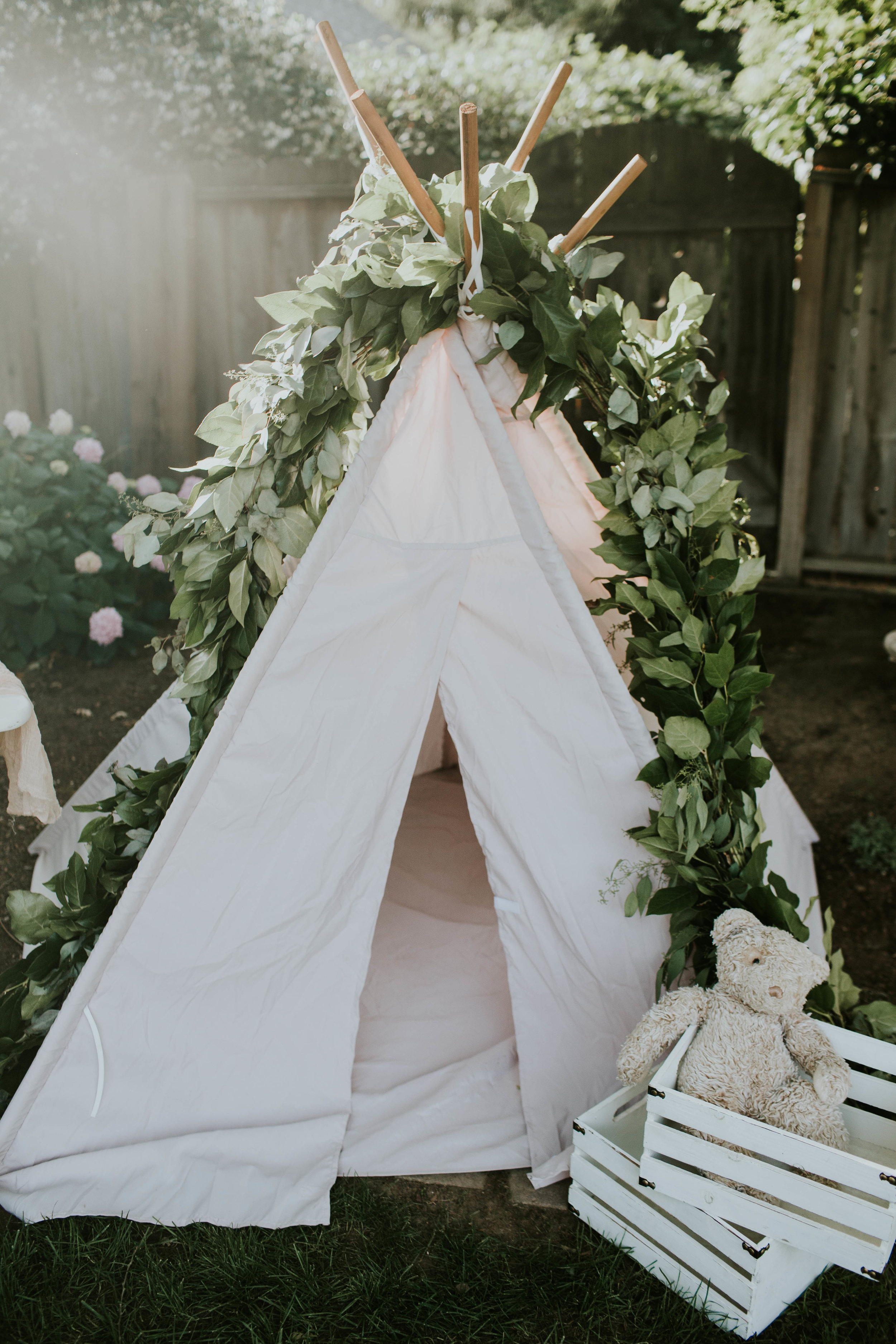   Greenery Garland; Kathryn of KB Flowers   Teepee: My friend Jessie   Photo: Amie Soares Photography   Design: Ribbon & Leaf Events  
