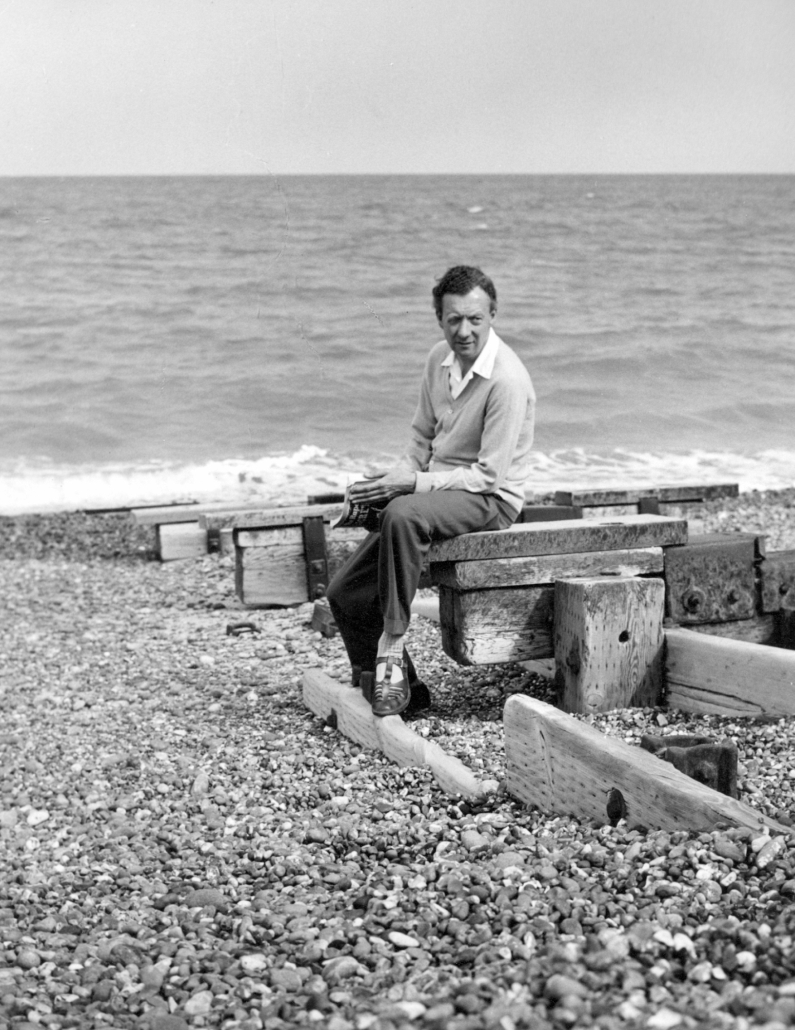 Britten on the beach at Aldeburgh, 1959. Photo by Hans Wild.