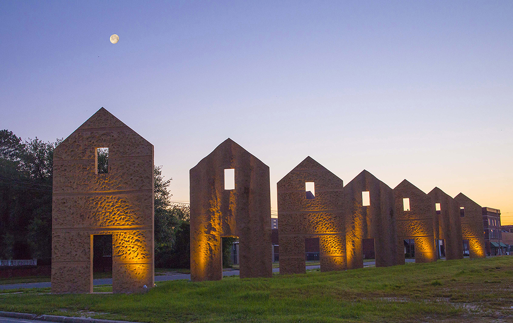 Thomas Sayre's earthcast installation  Flue , a series of barn shapes formed by concrete cast in a furrowed field and pulled into place, is located in downtown Kinston, NC. © 2017 Bill Russ