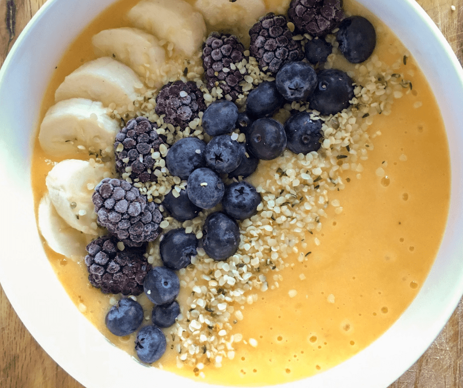 Coquina squash smoothie bowl with autumn blue fruits and hemp seeds
