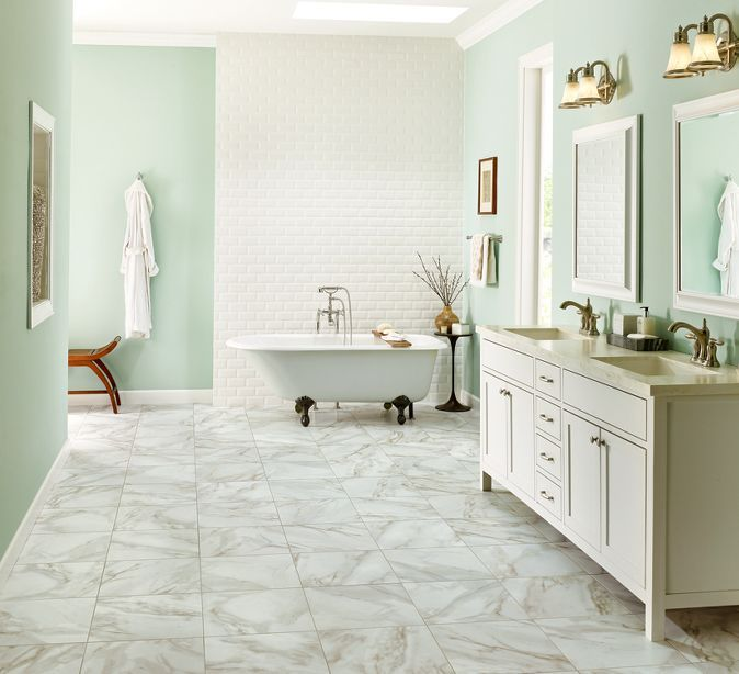 Design Tip #2 - Pair elegant marble with a cool color scheme for a luxurious spa-inspired retreat.