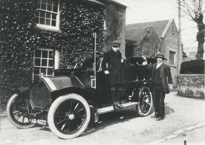 Frank John Bly standing on the side of the new company Humber Van, c 1911.