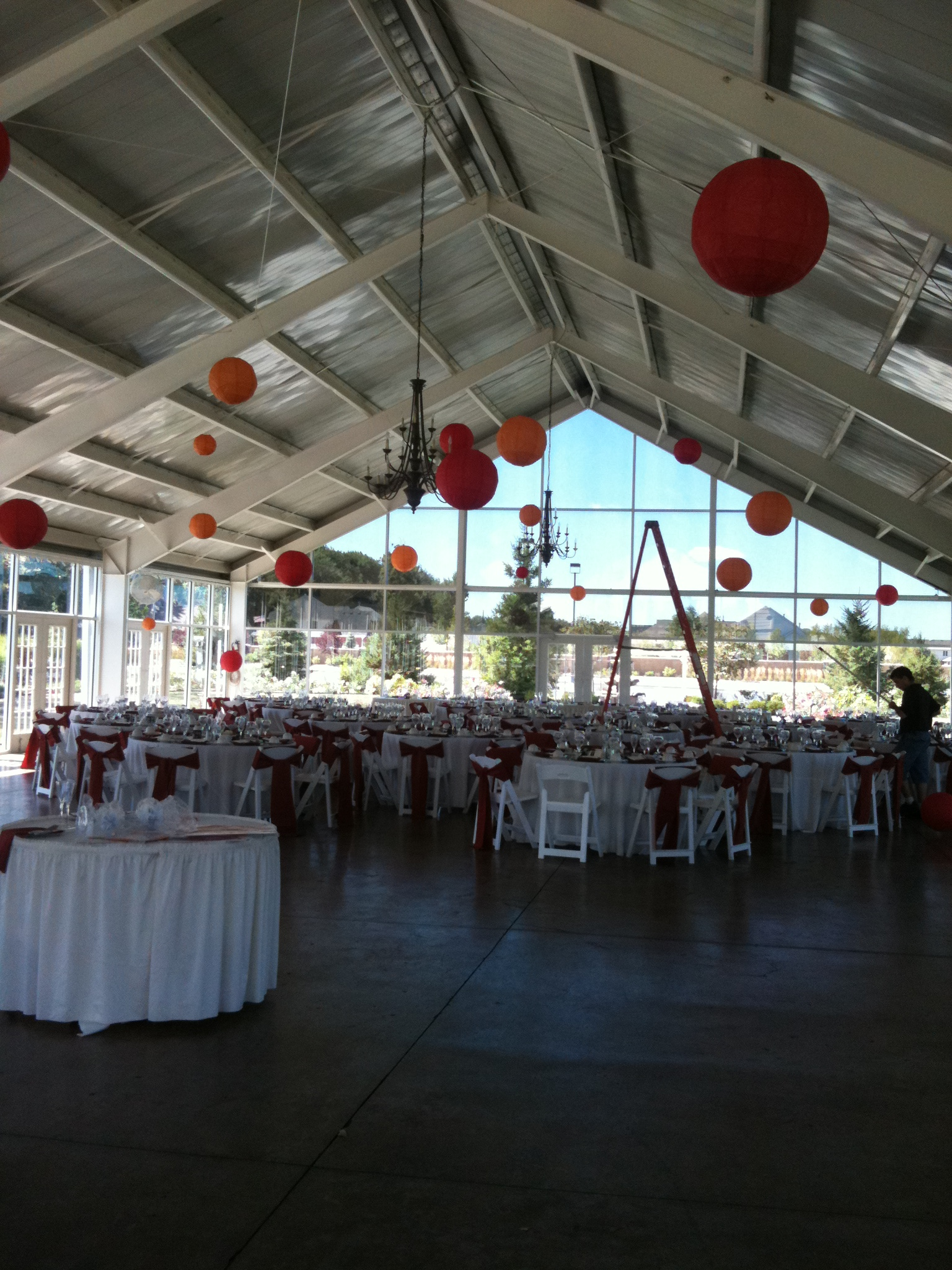 Reception Tent with round guest tables and red Chinese lanterns