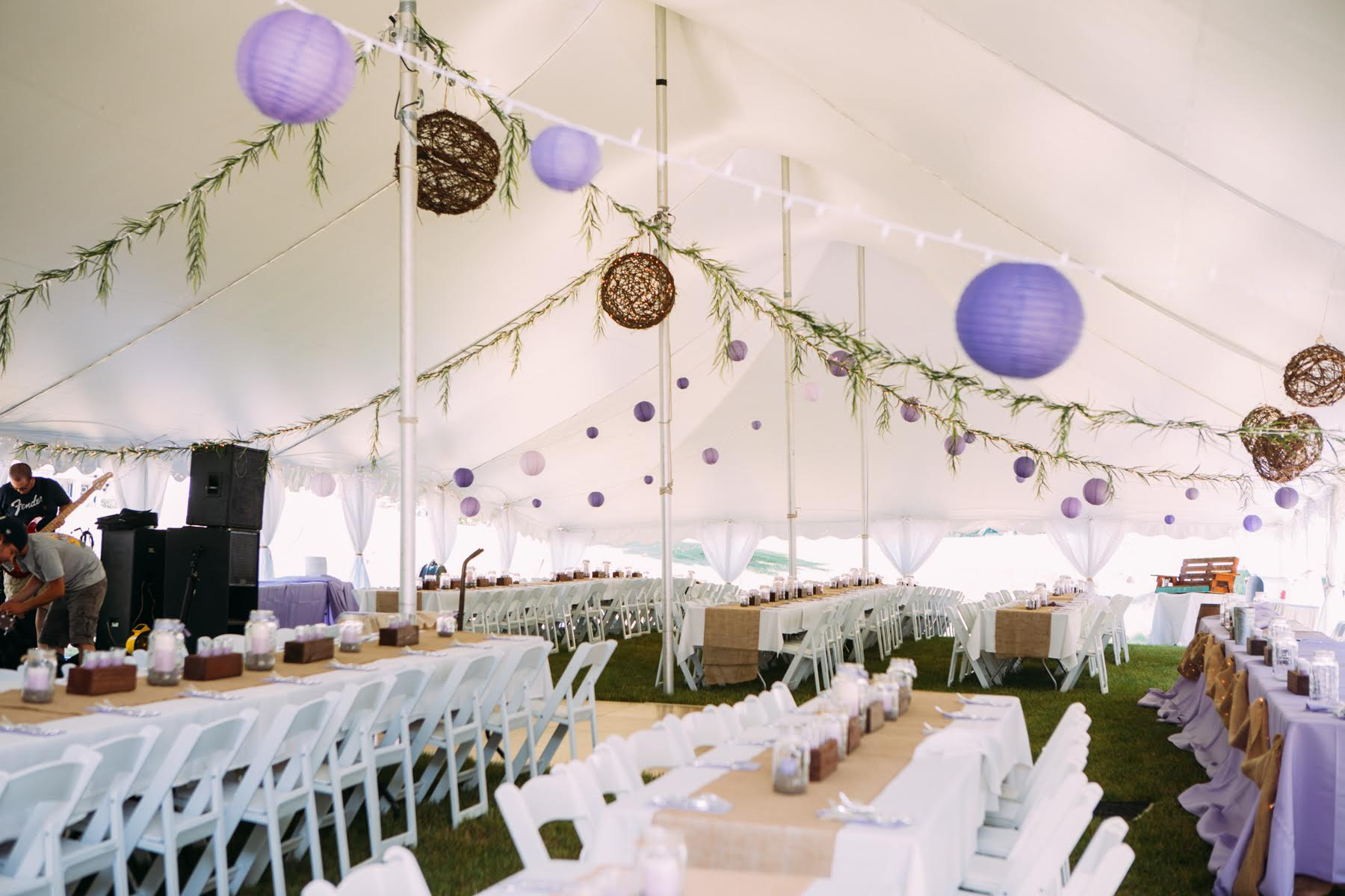Tented wedding reception with purple and tan chinese lanterns and burlap accents