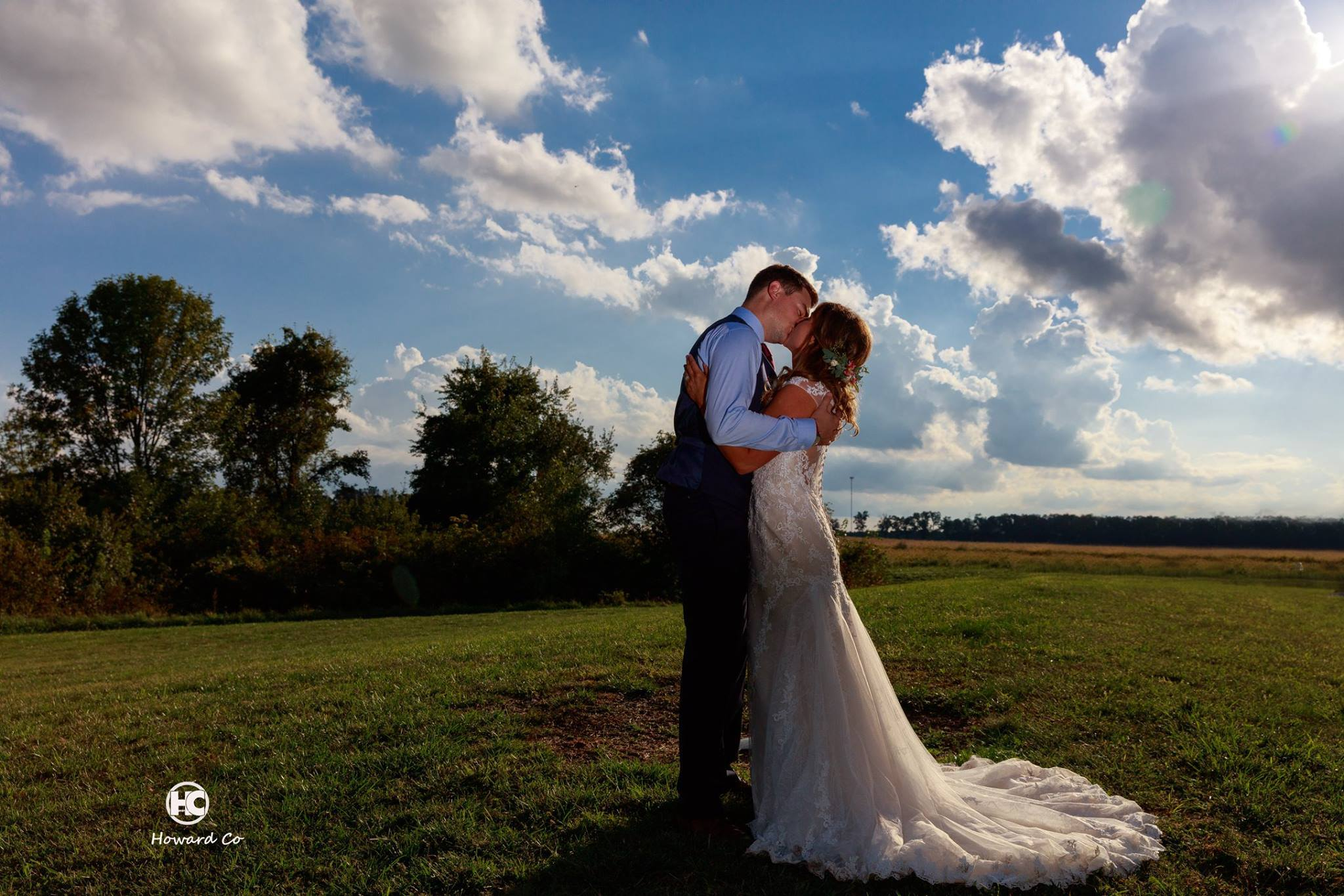 Beautiful sky picture of Bride and Groom kissing at the Legacy Barn in Kokomo, IN