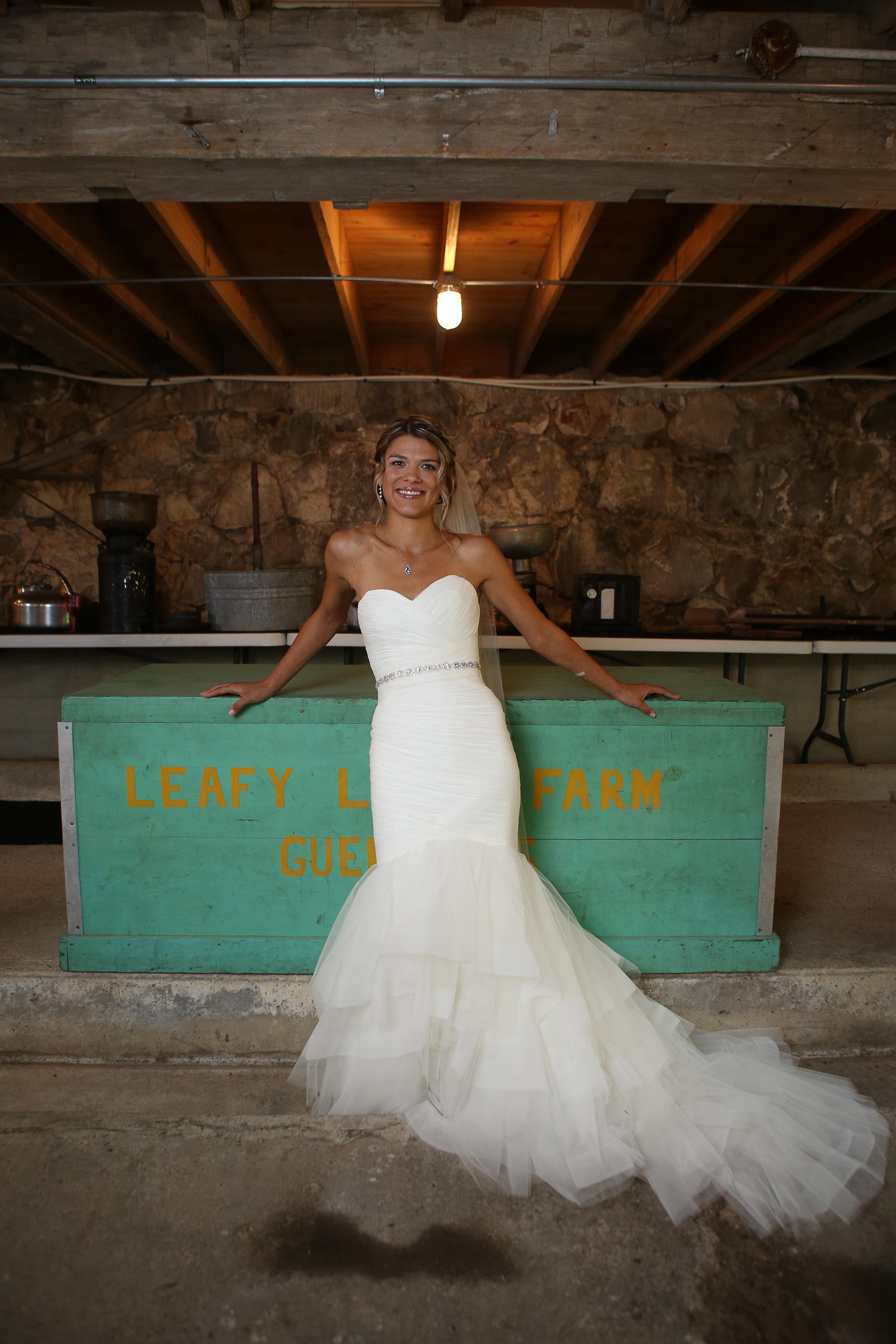 Beautiful Bride on her wedding day in a rustic Barn wedding