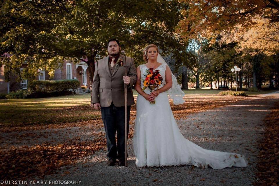 Bride and Groom pose as American Gothic on their wedding day