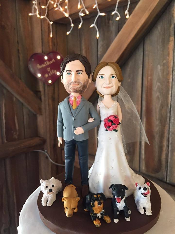 Cake topper customized to the image of the Bride and Groom with their dogs