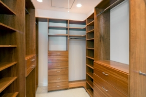 Walk-in-closet-lined-with-cherry-wood-built-ins.-Big-empty-walk-in-wardrobe-in-luxurious-house-min-e1440667597165.jpg