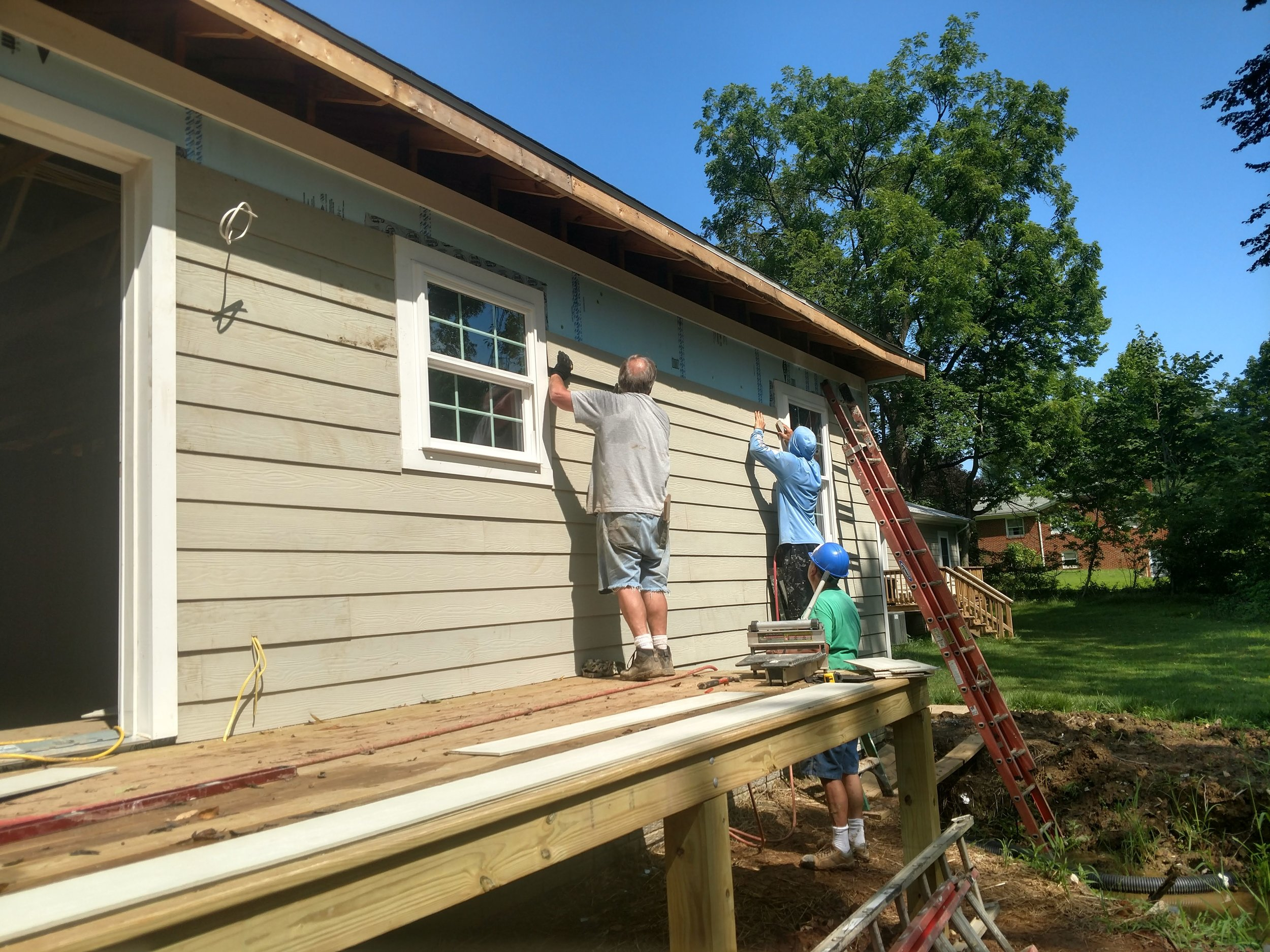 Siding going on back of house.jpg
