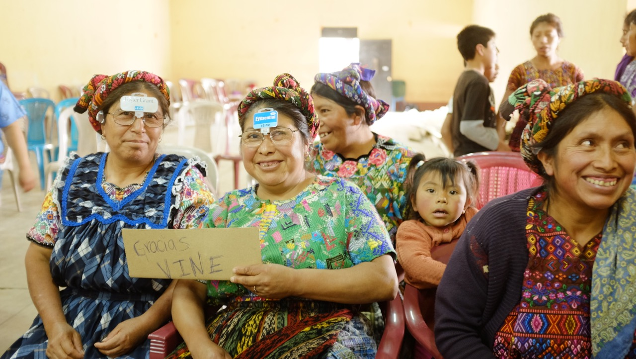Women who weave for a living receive glasses, enabling them to see their work again.