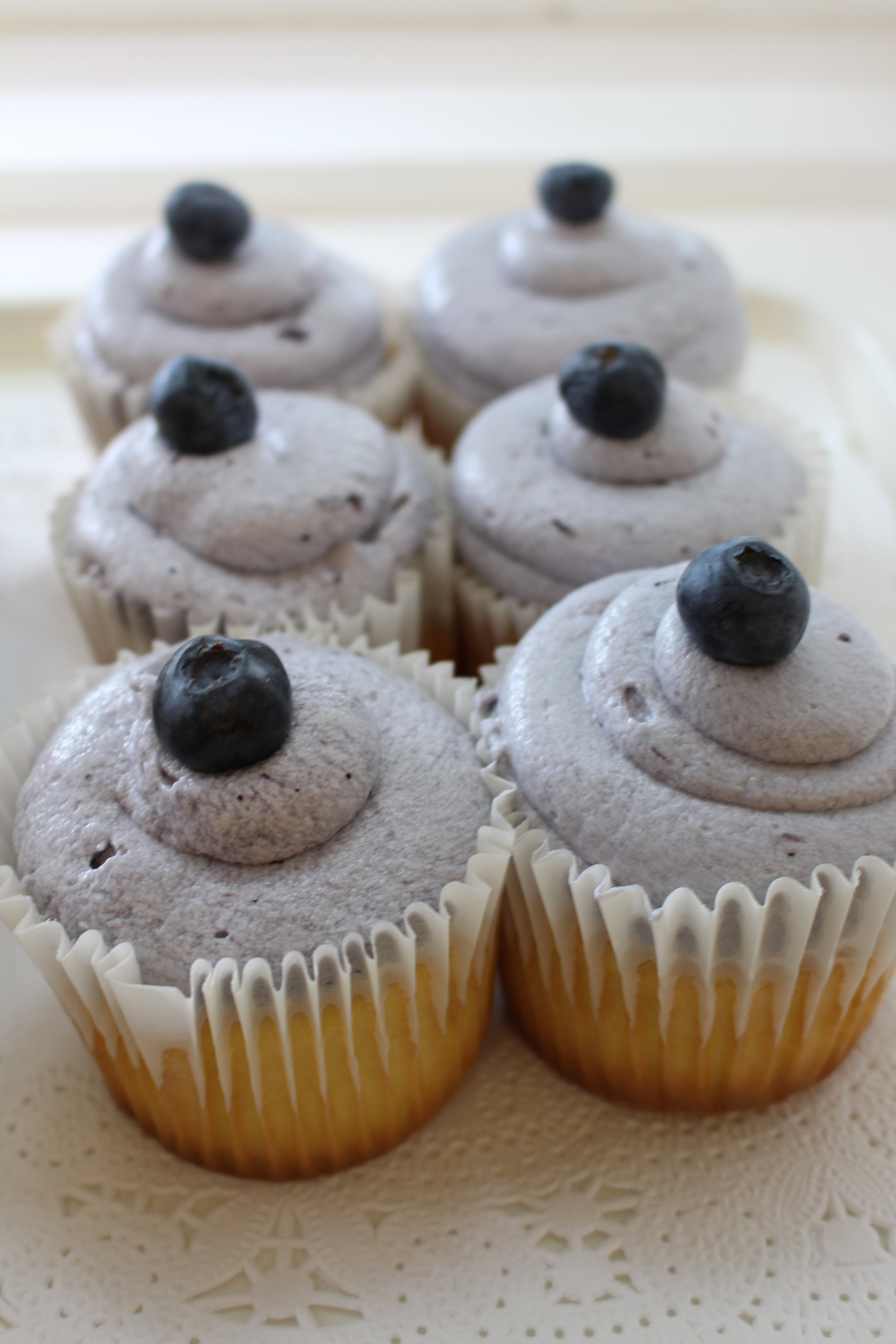 Lemon Cupcake with Blueberry Buttercream Frosting