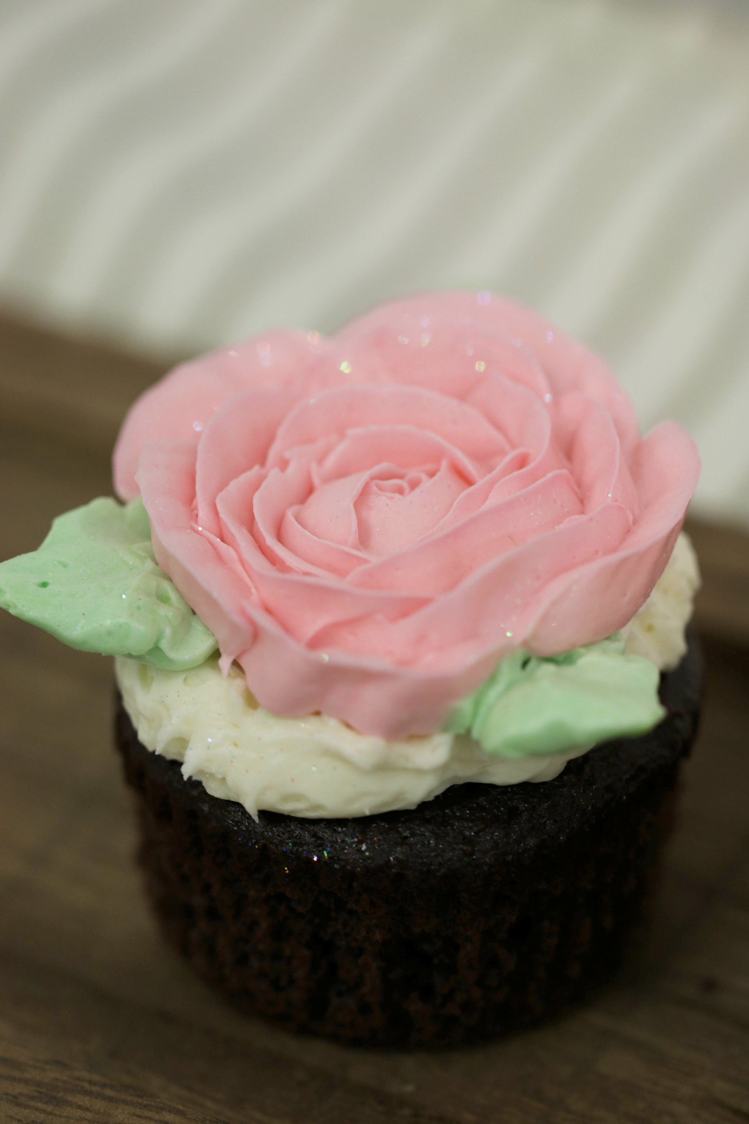 White cupcake with buttercream frosting