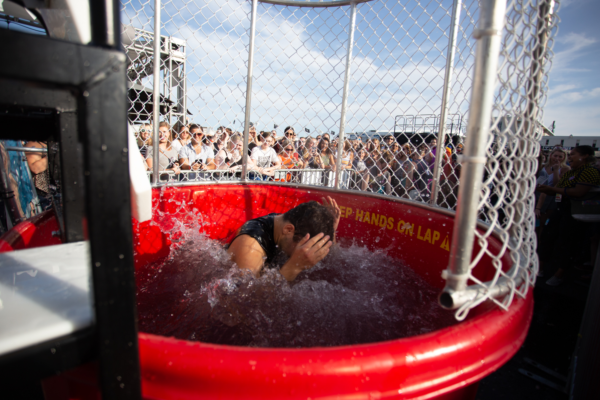 Jack Antonoff participates in a dunk tank for LGBTQ+ equality foundation The Ally Coalition at Shadow of the City festival in Asbury Park, NJ on August 25, 2018.