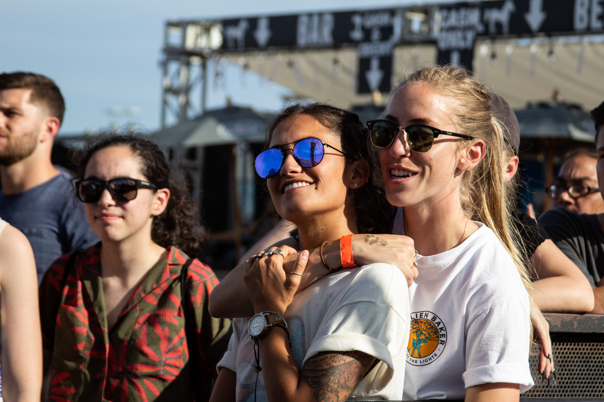 Hunter Stones (left) and Alexa Gruschow (right) watch Turnover from the crowd at Shadow of the City in Asbury Park, NJ on August 25, 2018.