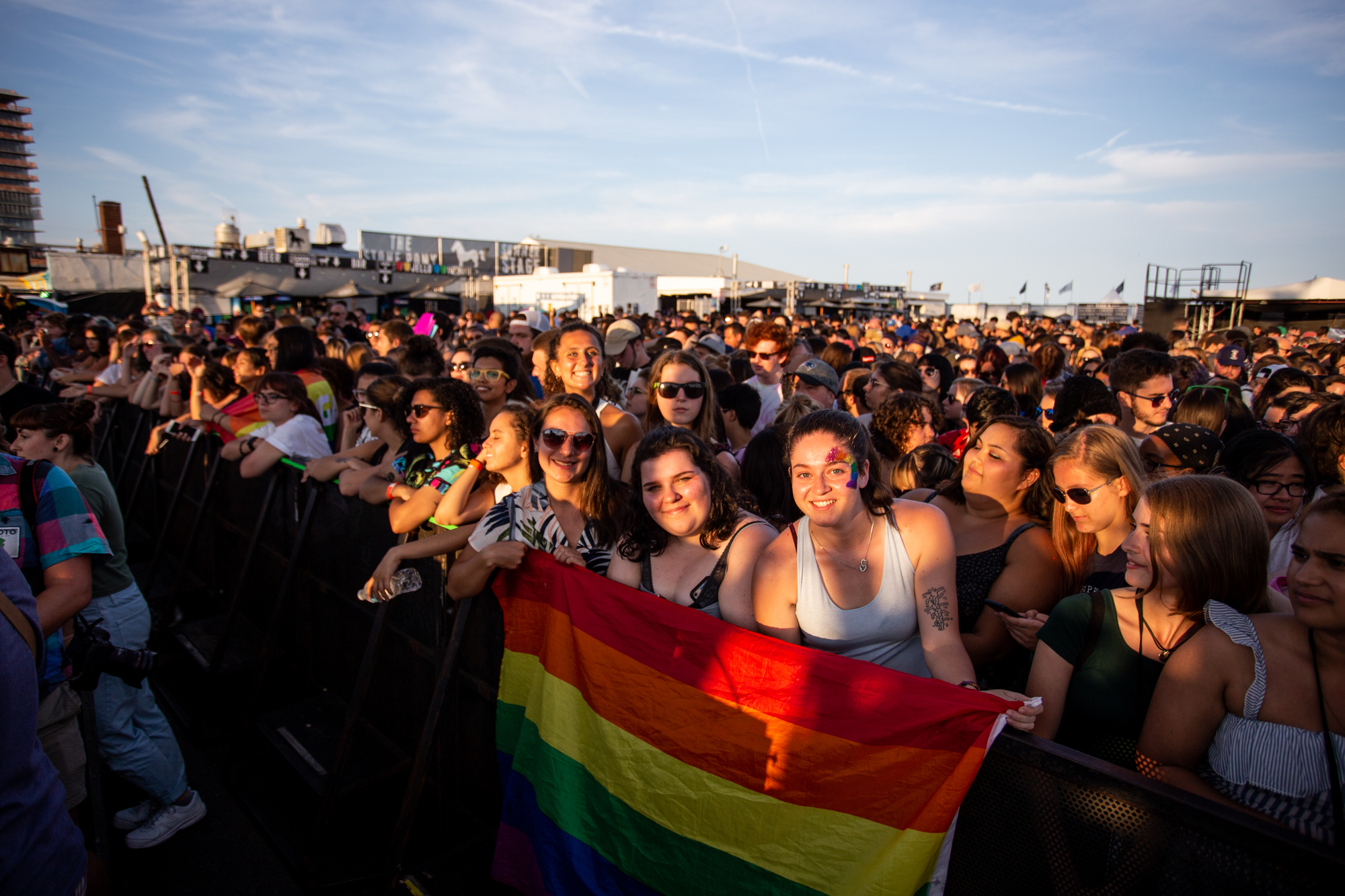 Priscilla McDade, Molly McDade and Brenna Ilg (left to right) wait at the front of the barricade to see Hayley Kiyoko at Shadow of the City festival in Asbury Park, NJ on August 25, 2018.