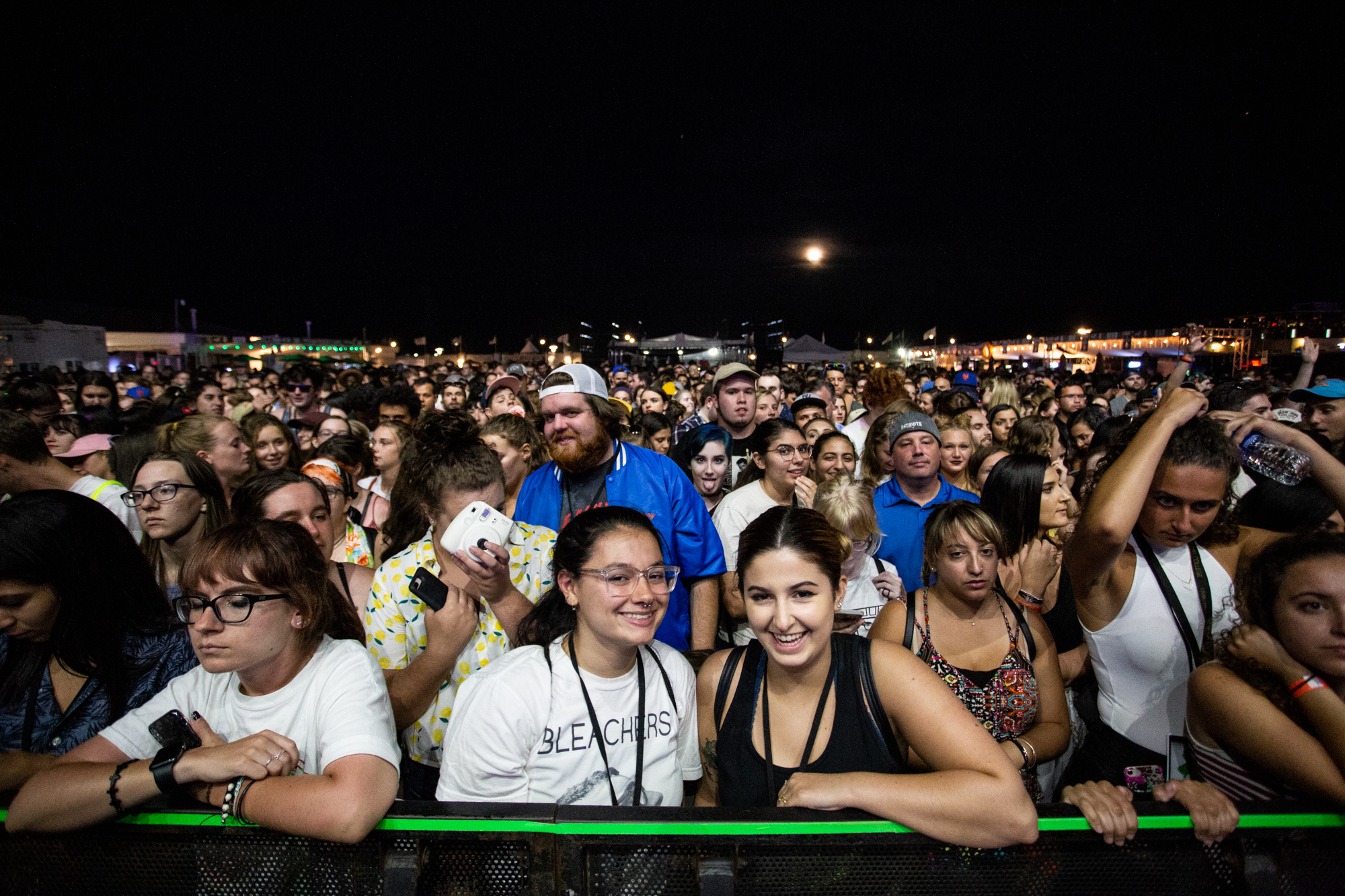 Gillian Carannante (left) and Ava Manganiello (right) wait front and center for Bleachers to perform at Shadow of the City festival in Asbury Park, NJ on August 25, 2018.