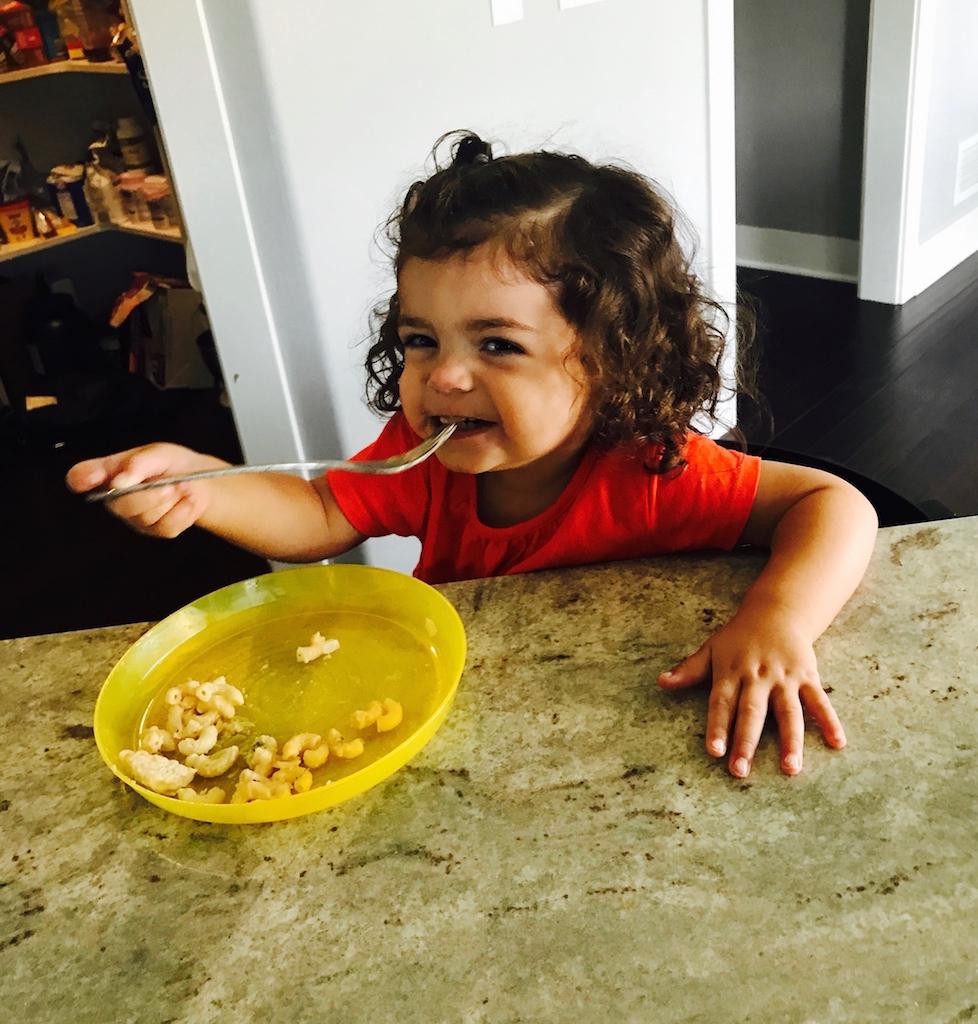 llittle girl eating mac and cheese smaller (on website).jpg
