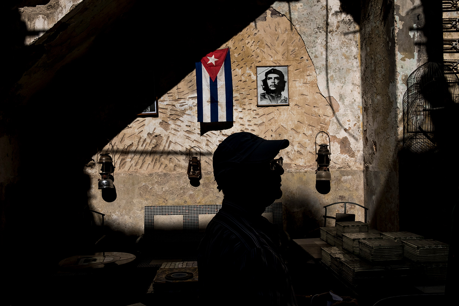 A salesman is silhouetted in a local market in Havana, Cuba.