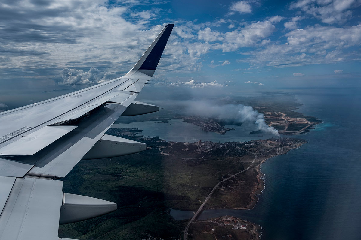 A JetBlue airplane descends to land into Havana, Cuba.
