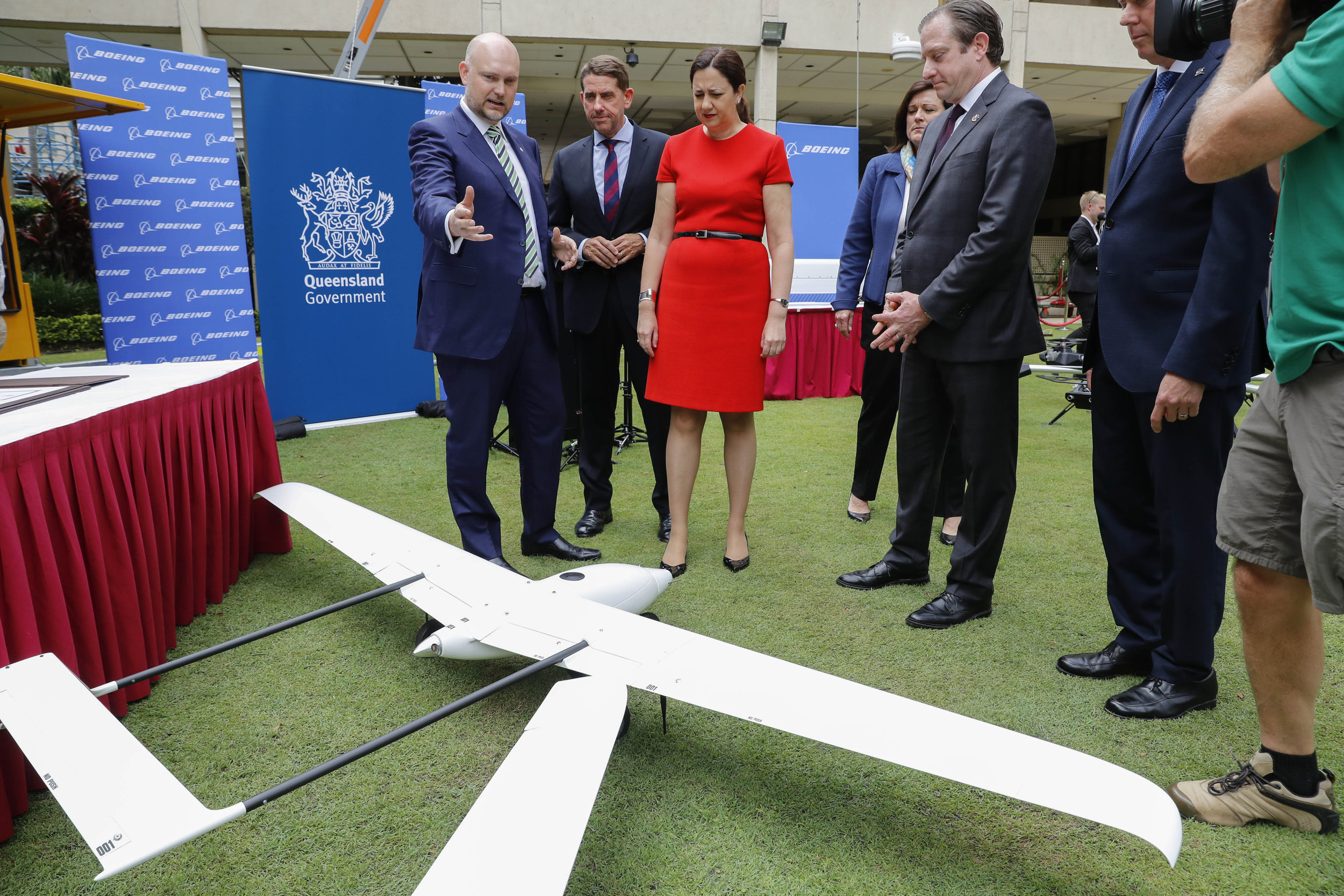 Premier Annastacia Palaszcuk (center) and State Development and Manufacturing Minister Cameron Dick (second from right) view Albatross UAVs. (Source: Glenn Hunt/AAP)