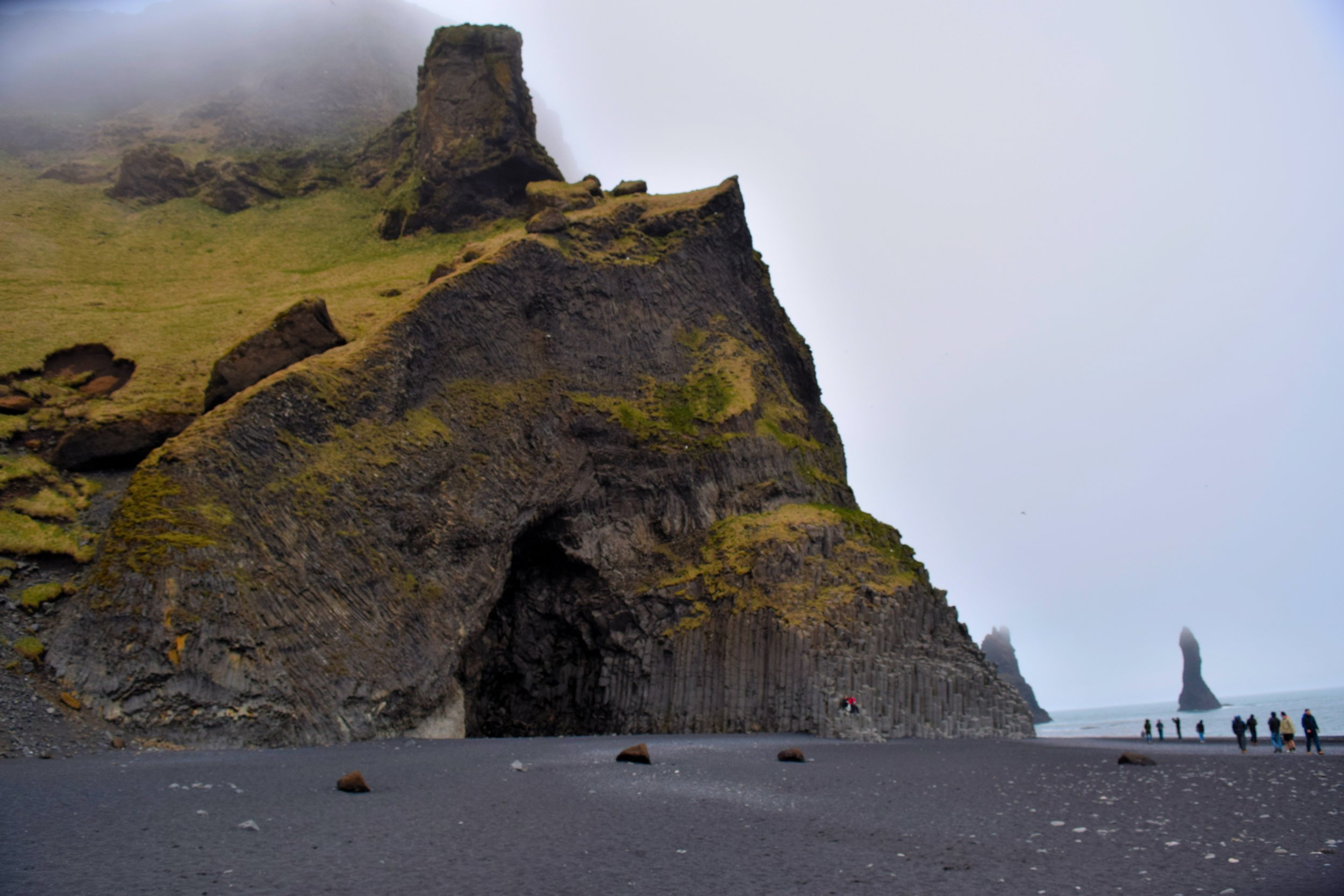 Black sand and caves in Reynisfjara, Iceland.