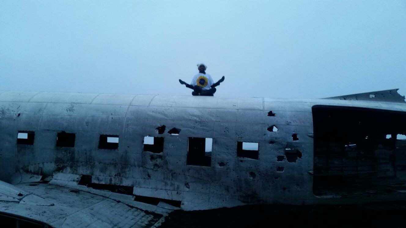 Meditating on an abandoned plane in Solheimasandur, Iceland.