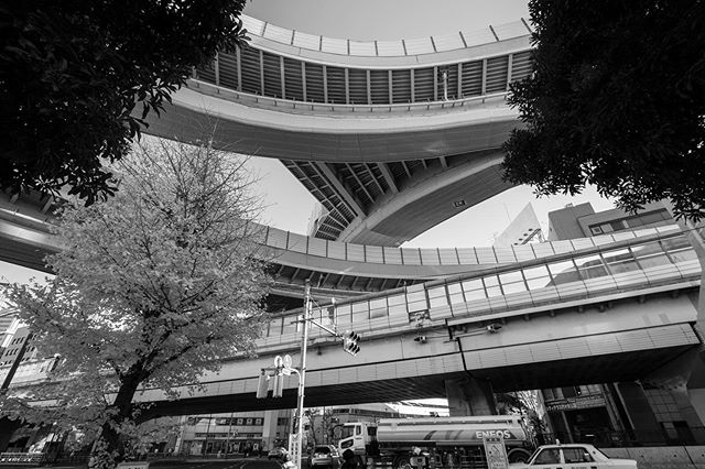 City Lines #12 — Huge intersection in Tokyo. (There's also a tunnel that is not visible in this picture.) The city houses more than 30 million people, but compared to other cities in Japan has a very low number of 0.46 cars per household. (2012) . . . . . #CityLines #Architecture #Urban #Urbanlandscape #City #Ciudad #Cidade #Urbano #Photography #Photo #blackwhite #monochrome #monocromatica #blancoynegro #still #BW #BN #pb