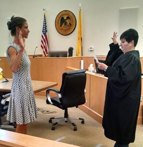 Volunteer Yarrow Dankert is sworn in by Judge Mercedes Murphy